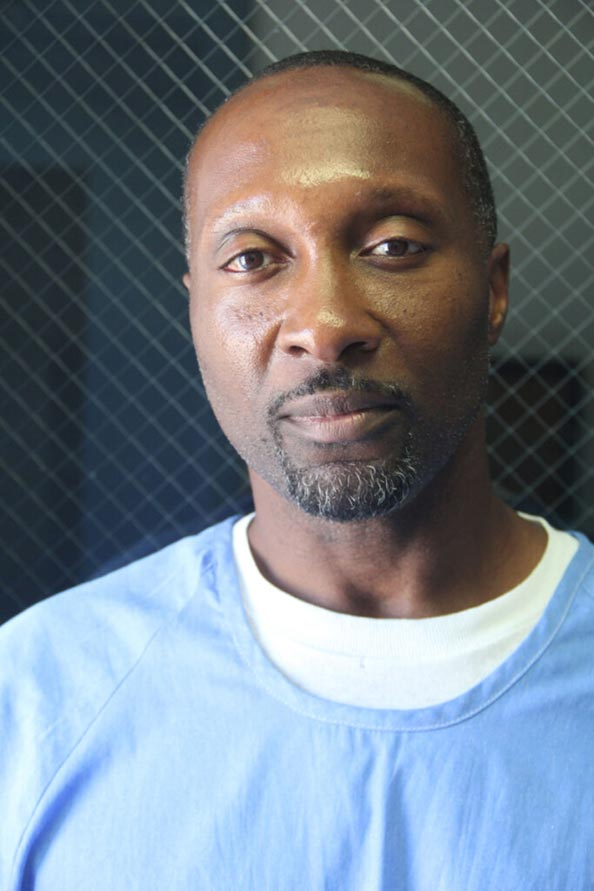 Portrait of incarcerated African American male with soft gaze