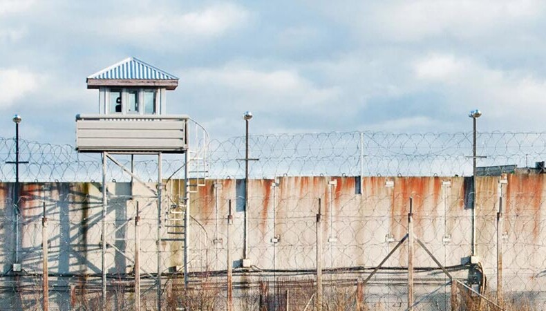 Correctional officer guard tower and outside prison wall
