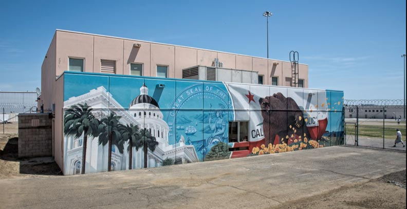 Outside mural of bear and outdoors with government building