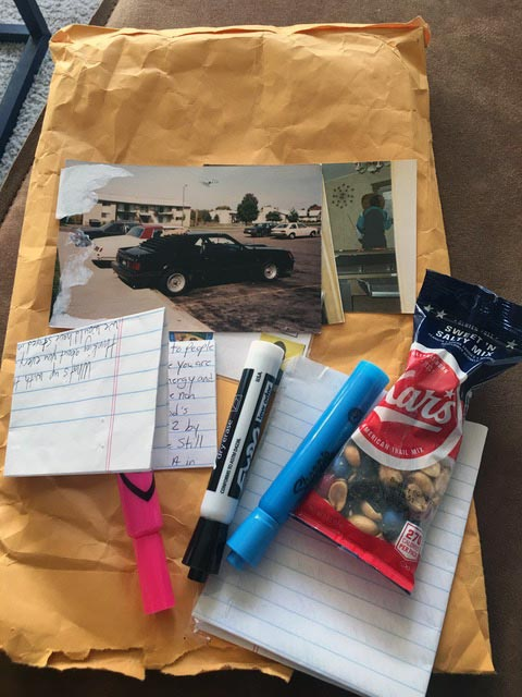 Contents of package - pens, markers, letter, bag of peanute, photo of truck