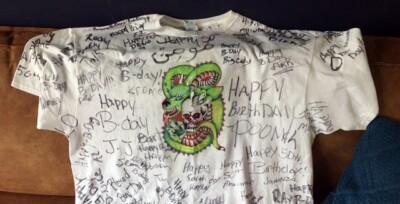 T-shirt with picture of dragon and happy birthday signatures written all over it