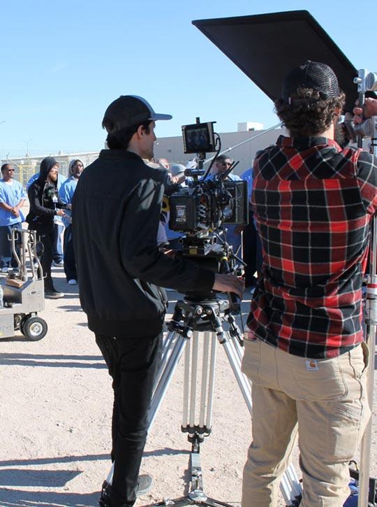Documentary crew members standing with equipment waiting
