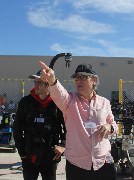 Man pointing and discussing something with a documentary crew member