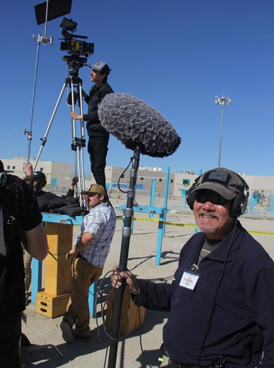 Boom operator smiling while on set of Step Inside The Circle documentary