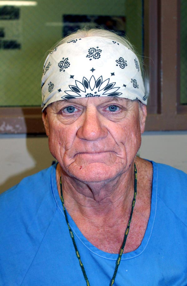 Portrait of an elderly incarcerated man wearing white bandana