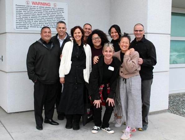 Group photo of Compassion Prison Project staff and volunteers standing outside