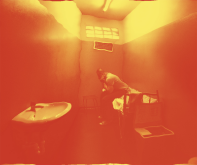 Man sitting in hot prison cell