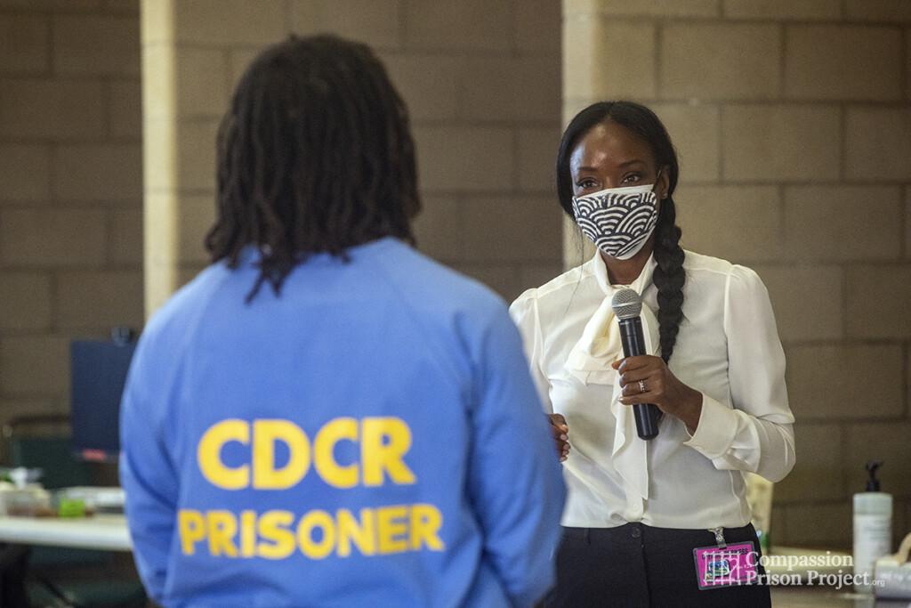 Nadine Burke Harris speaking to a man living in prison