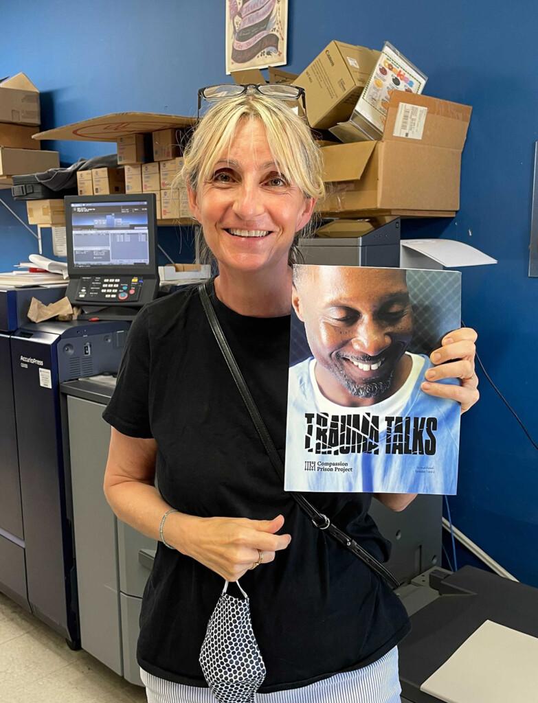 Woman (Fritzi) holding CPP's Trauma Talks curriculum workbook